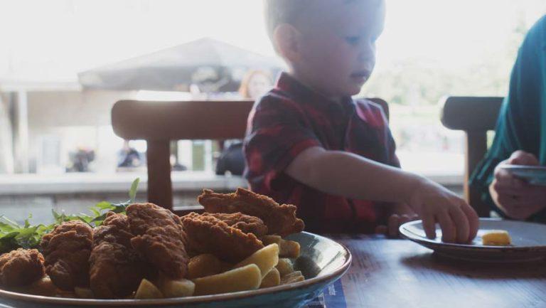 child eating goujons