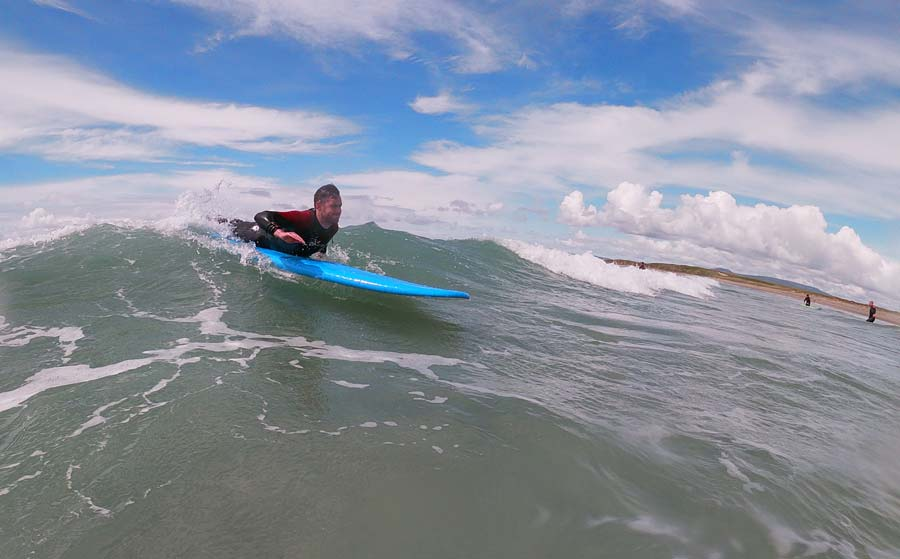 Learning to surf at Carrowniskey Beach with Surf Mayo