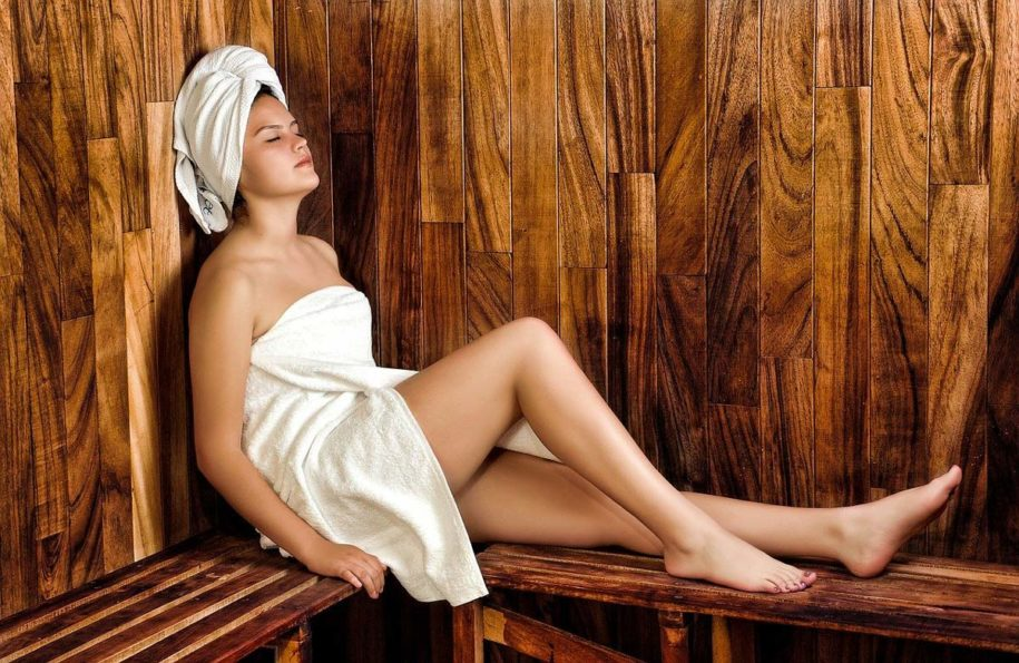 lady in towel in sauna
