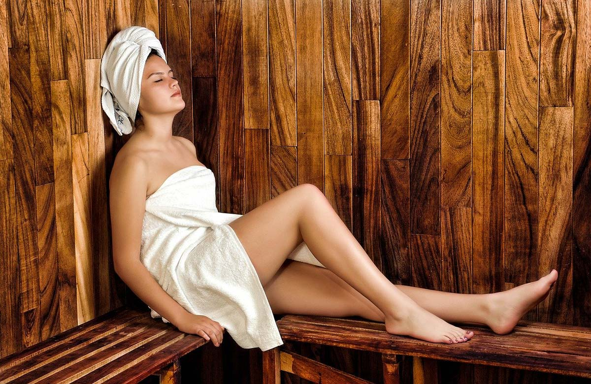 lady in towel in sauna